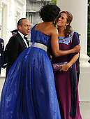 First Lady Michelle Obama embraces Mexican First Lady Margarita Zavala as President Felipe Calderon of Mexico looks on while Mrs. Obama and United States President Barack Obama welcome them on the North Portico of the White House for a State Dinner in Washington on May 19, 2010.   .Credit: Roger L. Wollenberg - Pool via CNP