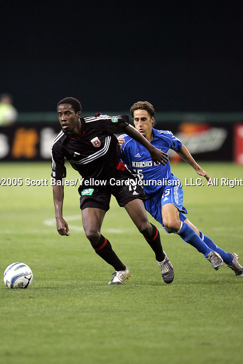 21 May 2005: DC United's Clyde Simms dribbles away from Kansas City's Josh Wolff. DC United defeated the Kansas City Wizards 3-2 at RFK Stadium in Washington, DC in a regular season Major League Soccer game. .