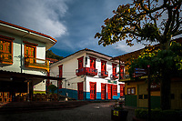 Brightly painted colonial houses are seen on the main plaza during the sunrise in Jericó, a village in the coffee region (Zona cafetera) of Colombia, 24 April 2018.