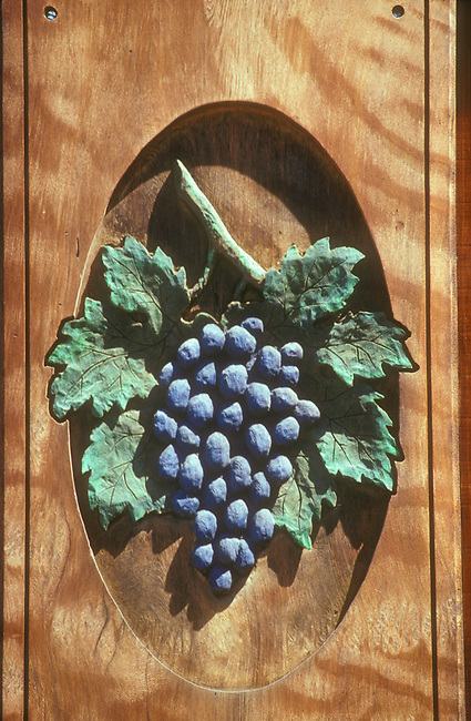 Wood carving on door of winery