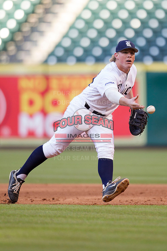 Rice Owls first baseman Skyler Ewing #44 tosses the ball to the pitcher covering first base during the NCAA baseball game against the North Carolina Tar Heels on March 1st, 2013 at Minute Maid Park in Houston, Texas. North Carolina defeated Rice 2-1. (Andrew Woolley/Four Seam Images).