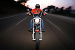 SAN DIEGO, CA - JULY 21:  Helmut Herb rides a Harley Davidson Softtail on Pacific Coast Highway during the Harley Davidson Release test ride for Stern Magazine on July 21 in San Diego, California. (Photo by Donald Miralle) *** Local Caption *** Helmut Werb