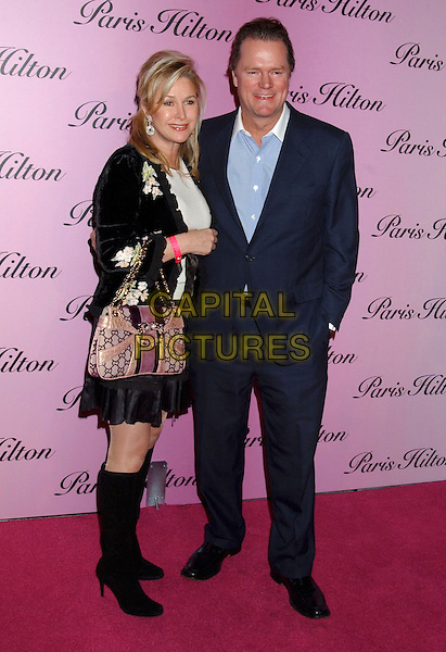 "KATHY HILTON & RICK HILTON.At the launch of duaghter Paris Hilton's new fragrance ""Paris Hilton"", Los Angeles, California, USA,.3rd December 2004. .full length parents mother father married husband wife Gucci bag black knee high boots.**UK SALES ONLY**.Ref: ADM.www.capitalpictures.com.sales@capitalpictures.com.©L.Farr/AdMedia/Capital Pictures ."