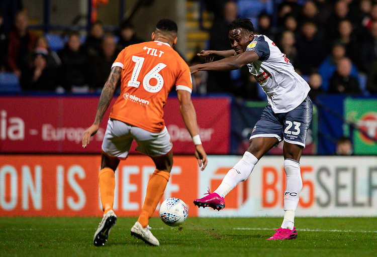Bolton Wanderers' Joe Dodoo (right) shoots at goal under pressure from  Blackpool's Curtis Tilt <br /> <br /> Photographer Andrew Kearns/CameraSport<br /> <br /> The EFL Sky Bet League One - Bolton Wanderers v Blackpool - Monday 7th October 2019 - University of Bolton Stadium - Bolton<br /> <br /> World Copyright © 2019 CameraSport. All rights reserved. 43 Linden Ave. Countesthorpe. Leicester. England. LE8 5PG - Tel: +44 (0) 116 277 4147 - admin@camerasport.com - www.camerasport.com