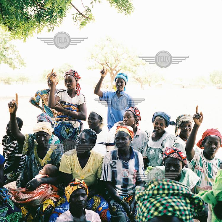 Women are taught about malaria in a remote village in Namentenga.
