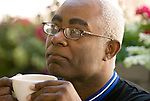 African American man drinking coffee, thoughtful