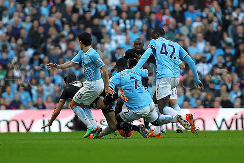 09.03.2014 Manchester, England. The Wigan and Manchester City teams battle for everything during the FA Cup 6th Round match between  Manchester City and Wigan Athletic from The Etihad Stadium.