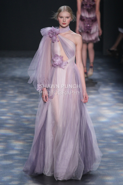 Model Eyla walks runway in a lilac and violet soft tulle Grecian gown with handmade feather and tulle flowers, from the Marchesa Fall 2016 collection by Georgina Chapman and Keren Craig, presented at NYFW: The Shows Fall 2016, during New York Fashion Week Fall 2016.