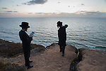 Ultra-Orthodox Jewish children pray and throw a stone into the sea during a 'Tashlich' ritual along the Mediterranean Sea in Herzliya, central Israel. 'Tashlich' ('to cast away') is a Jewish practice by which believers go to a flowing body of water and symbolically 'throw away' their sins, before the Day of Atonement ('Yom Kippur'), the holiest day in the Jewish calendar.