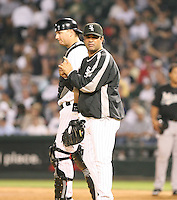 Ozzie Guillen and A.J. Pierzynski of the Chicago White Sox vs. the Florida Marlins: June 19th, 2007 at Wrigley Field in Chicago, IL.  Photo by Mike Janes/Four Seam Images