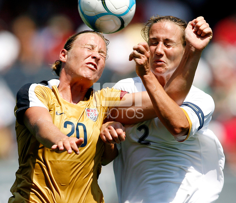 U.S. forward Abby Wambach (20) heads the ball in front of New Zealand midfielder Rebecca Smith (2).  The U.S. Women's National Team defeated New Zealand 6-1 at Soldier Field in Chicago, IL on August 12, 2007.