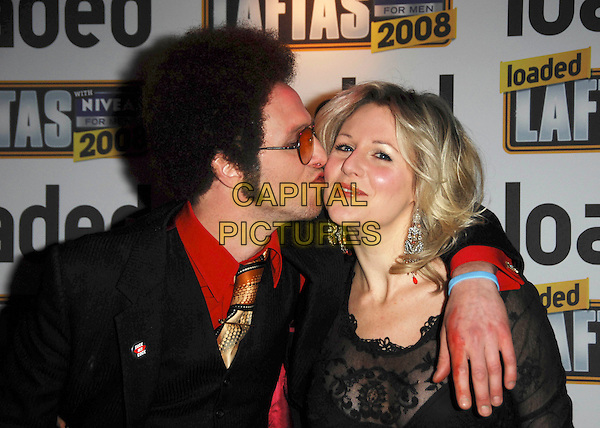 PAUL KAYE & ABI TITMUSS.Loaded Laftas Comedy Awards held at the Cuckoo Club, London, England, October 2nd 2008..half length black top sheer see through lace bra arm around shoulder wig costume sunglasses gold tie kissing cheek .CAP/TTL .©TTL/Capital Pictures