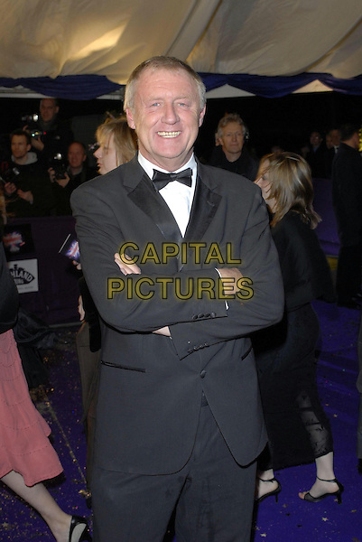 CHRIS TARRANT .at the British Comedy Awards 2006, London Television Studios, London, UK. December 13th, 2006 .half length black suit bow tie arms folded crossed tux tuxedo smiling .CAP/FIN.©Steve Finn/Capital Pictures.