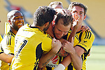 Phoenix players celebrate after team mate Jeremy Brockie, centre, scores against the Brisbane Roar in the A-League football match at Westpac Stadium, Wellington, New Zealand, Sunday, January 04, 2015. Credit: Dean Pemberton