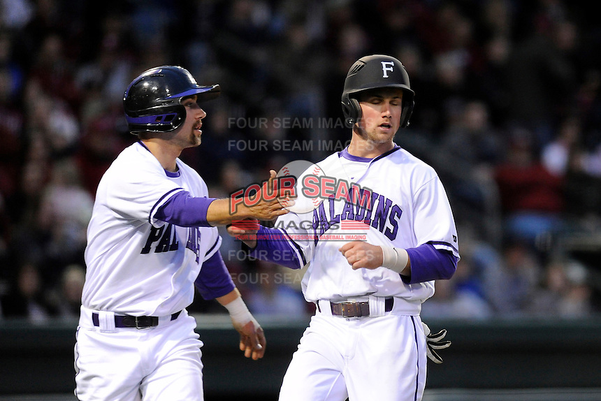 Outfielder Will Muzika (2) of the Furman Paladins is congratulated after scoring a run in a game against the South Carolina Gamecocks on Wednesday, April 3, 2013, at Fluor Field at the West End in Greenville, South Carolina. (Tom Priddy/Four Seam Images)