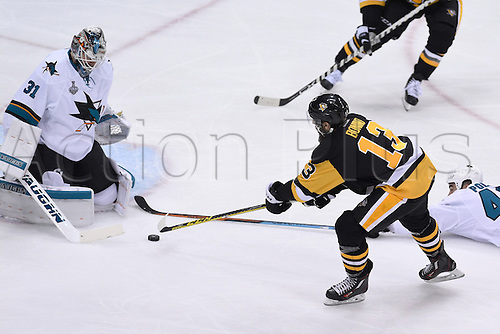 01.06.2016. Pittsburgh, Penn, USA.  Pittsburgh Penguins center Nick Bonino (13) puts a shot on San Jose Sharks goalie Martin Jones (31) that right wing Phil Kessel (81) (not pictured) would score on behind the Jones during the second period in the 2016 NHL Stanley Cup Final - Game Two between the San Jose Sharks and the Pittsburgh Penguins at the Consol Energy Center in Pittsburgh, Pennsylvania.