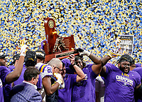 ATLANTA, GA - DECEMBER 7: head coach Ed Orgeron of the LSU Tigers raises the SEC Championship trophy during a game between Georgia Bulldogs and LSU Tigers at Mercedes Benz Stadium on December 7, 2019 in Atlanta, Georgia.
