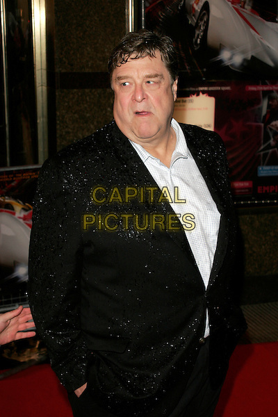 "JOHN GOODMAN.Arriving at the ""Speed Racer"" UK film premiere, Empire Leicester Square, London, England..April 28th 2008.half length black suit jacket wet raining hands in pockets .CAP/AH.©Adam Houghton/Capital Pictures."
