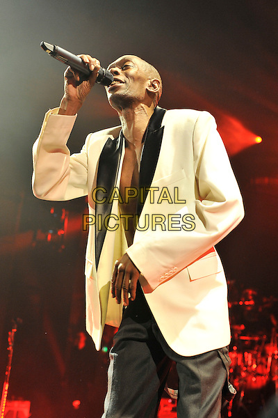 FAITHLESS - Maxi Jazz.Performing live at the Brixton Academy, London, England..April 7th, 2011.stage concert live gig performance music half length black trousers white singing jacket.CAP/MAR.© Martin Harris/Capital Pictures.
