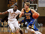 SIOUX FALLS, SD - NOVEMBER 26:  A.J. Hess #35 from South Dakota State University drives past David Burrell #3 from East Tennessee State University during their game at the Sanford Pentagon Saturday evening in Sioux Falls. (Photo by Dave Eggen/Inertia)