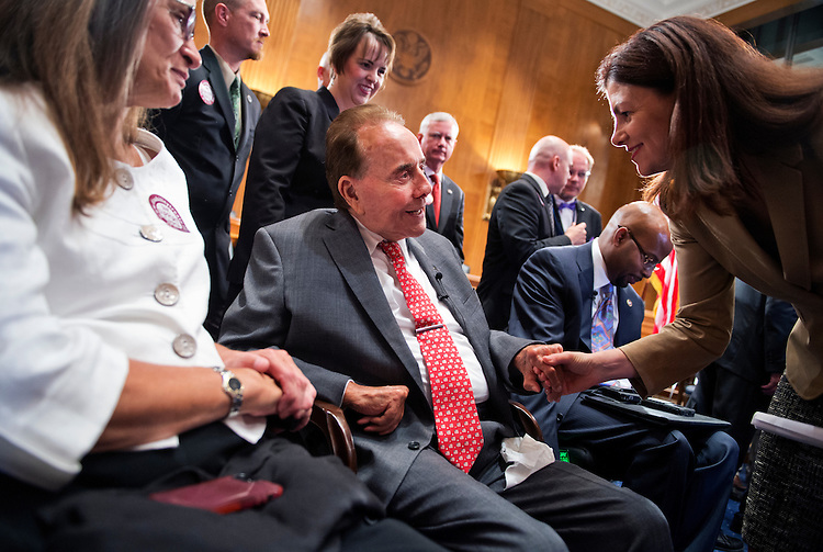 UNITED STATES - JULY 23: Former Senate Majority Leader Bob Dole, R-Kan., speaks with Sen. Kelly Ayotte, R-N.H., after a news conference in Dirksen Building to urge the Senate to ratify the Convention on the Rights of Persons with Disabilities, July 23, 2014. (Photo By Tom Williams/CQ Roll Call)