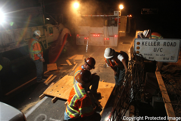 A construction crew working on the replacement of guardrails on I-215 at the Keller Road bridge in Murrietta, California in 2012.  photo for the Californian