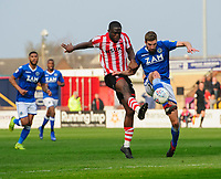 Lincoln City's John Akinde vies for possession with Macclesfield Town's Fiacre Kelleher<br /> <br /> Photographer Chris Vaughan/CameraSport<br /> <br /> The EFL Sky Bet League Two - Lincoln City v Macclesfield Town - Saturday 30th March 2019 - Sincil Bank - Lincoln<br /> <br /> World Copyright © 2019 CameraSport. All rights reserved. 43 Linden Ave. Countesthorpe. Leicester. England. LE8 5PG - Tel: +44 (0) 116 277 4147 - admin@camerasport.com - www.camerasport.com