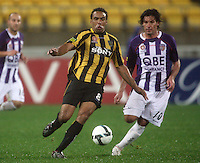 Phoenix striker Paul Ifill controls the ball under pressure from Wayne Srhoj during the A-League football match between Wellington Phoenix and Perth Glory at Westpac Stadium, Wellington, New Zealand on Sunday, 16 August 2009. Photo: Dave Lintott / lintottphoto.co.nz