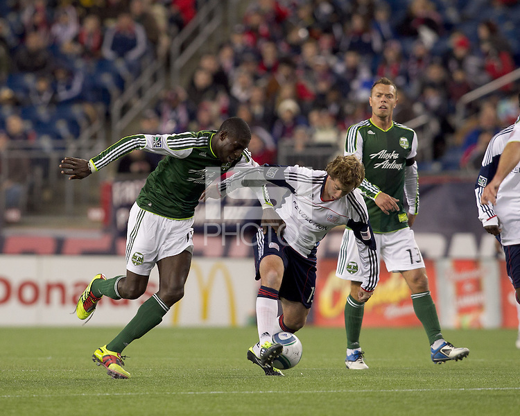 New England Revolution forward Zack Schilawski (15) attempts to control the ball in a crowd. In a Major League Soccer (MLS) match, the New England Revolution tied the Portland Timbers, 1-1, at Gillette Stadium on April 2, 2011.