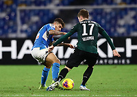 1st December 2019; Stadio San Paolo, Naples, Campania, Italy; Serie A Football, Napoli versus Bologna; Giovanni Di Lorenzo of Napoli wins the ball from Andreas Skov Olsen of Bologna to clear his box for Napoli - Editorial Use