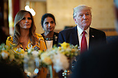 United States President Donald Trump (R) and first lady Melania Trump (L) listen as Indian Prime Minister Narendra Modi delivers remarks during dinner at the White House June 26, 2017 in Washington, DC. Trump and Modi met earlier today in the Oval Office to discuss a range of bilateral issues.  <br /> Credit: Mark Wilson / Pool via CNP