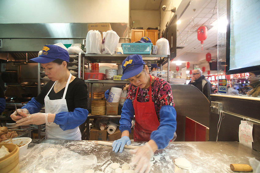 BROOKLYN, NY - JANUARY 15, 2016:  Workers assemble dumplings in the food court at Fei Long Market. The market combines a shopping center, food court and a large supermarket under one roof. <br /> LOCATION: 6301 8th Avenue between 63rd and 64th Streets.<br /> CREDIT: Clay Williams for the New York Times.<br /> <br /> &copy; Clay Williams / claywilliamsphoto.com