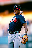 Andruw Jones of the Atlanta Braves during a game at Dodger Stadium in Los Angeles, California during the 1997 season.(Larry Goren/Four Seam Images)