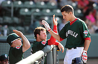 Infielder Nick Natoli (12) of the Greenville Drive, right, is congratulated in the dugout after hitting a rome run in a game against the Rome Braves on May 6, 2012, at Fluor Field at the West End in Greenville, South Carolina. Greenville won, 11-3. (Tom Priddy/Four Seam Images)