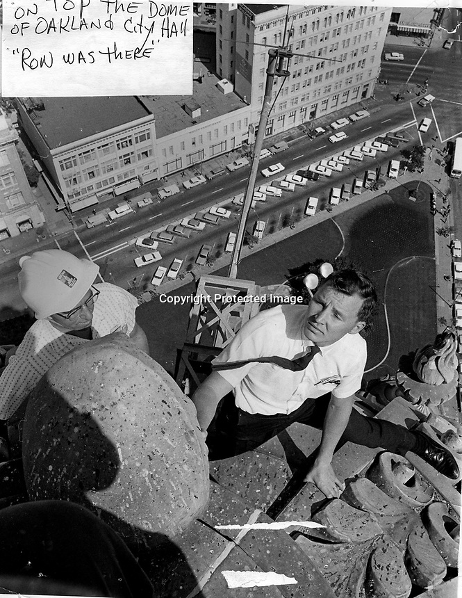 Ron foolishly climbs atop the Oakland City Hall dome for photo.