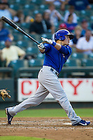 Iowa Cubs second baseman Logan Watkins (6) follows through on his swing against the Round Rock Express in the Pacific Coast League baseball game on July 21, 2013 at the Dell Diamond in Round Rock, Texas. Round Rock defeated Iowa 3-0. (Andrew Woolley/Four Seam Images)
