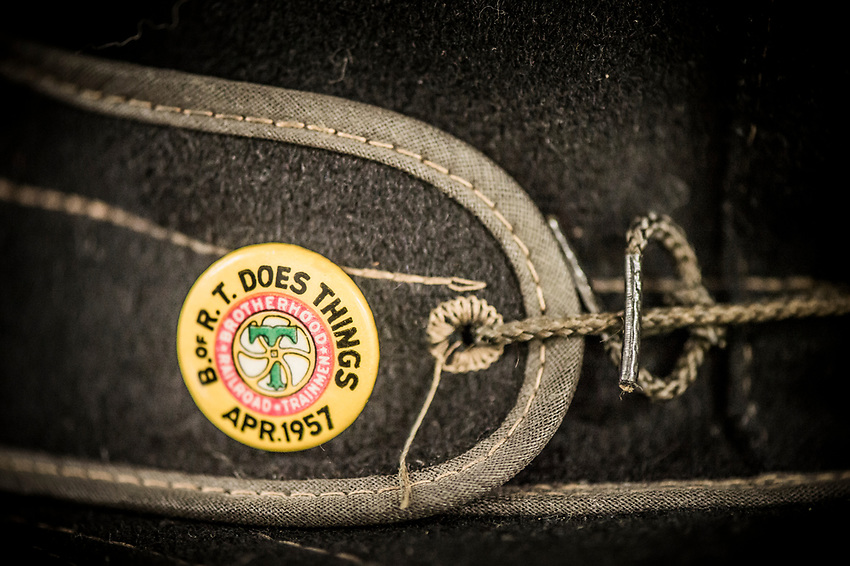 Detail of a pin on an original Stormy Kromer hat hints at the hat's railroad heritage.