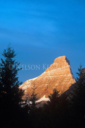 Sunrise on mountain peak in Glacier National Park