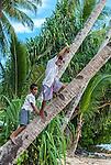 Boys playing on a swing at dusk in Funafuti, Tuvalu