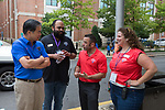 DePaul President A. Gabriel Esteban, Ph.D., talks with Rick Moreci, Director of Housing Services, during Move In Day. Rod Waters and Victoria Van Kirk Pride look on.  Photo by Diane M. Smutny