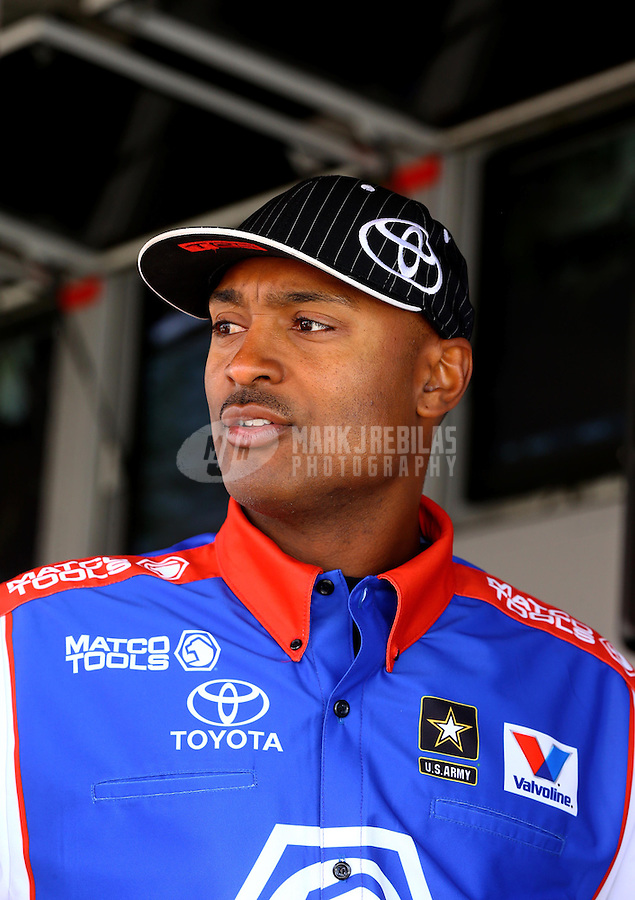 May 31, 2014; Englishtown, NJ, USA; NHRA top fuel dragster driver Antron Brown during qualifying for the Summernationals at Raceway Park. Mandatory Credit: Mark J. Rebilas-