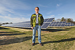 Trey Hill, Partner, Harborview Farms, stands in front of the 200 kW solar array at the Sustainable Agriculture Celebration at Harborview Farms on Thursday, December 6, 2012 in Rock Hall, MD. Harborview Farms is one of the largest and most sustainably driven farming operations in Maryland. (Larry French/AP Images for DuPont)..