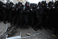 Riot police (Berkut) defending the Kiev city council building, attacked by the protester as a consequence of  the Ukrainian  government's decision to stall on a deal that would bring closer ties with the European Union.