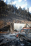 Houses inside of the Fourmile Canyon Fire near Boulder, Colorado in the wildland-urban interface.  The 7,000 acre fire claimed nearly 170 houses in the first days of the blaze.  Several of the houses that were saved had properly prepared their land for the potential of wildfire, including building with fire resistant materials as well as preparing defensible, fuel-minimized spaces in the areas surrouding the structure.