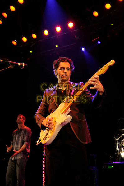 Dweezil Zappa.Performing Zappa Plays Zappa, Roundhouse, Camden, London, England, UK, 10th November 2012..music concert gig live on stage half length playing guitar .CAP/MAR.© Martin Harris/Capital Pictures.