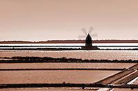 Salt pans near Ettore Infesera windmill, Masala Sicily. travel stock photos