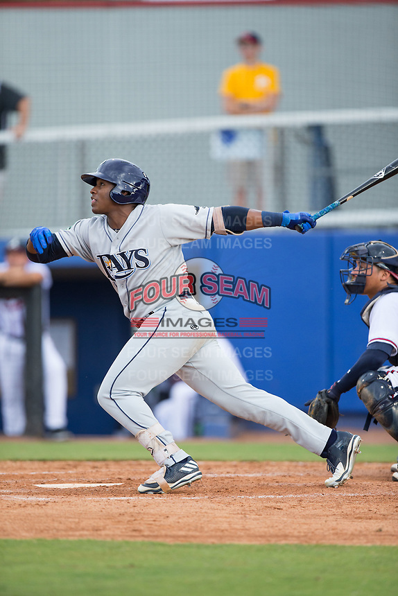Moises Gomez (21) of the Princeton Rays follows through on his swing against the Danville Braves at American Legion Post 325 Field on June 25, 2017 in Danville, Virginia.  The Braves walked-off the Rays 7-6 in 11 innings.  (Brian Westerholt/Four Seam Images)