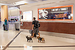 A man leads his dogs in the domestic terminal at Hartsfield–Jackson Atlanta International Airport, in Atlanta, Georgia on August 28, 2013.
