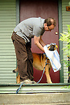 Rowland, mixed breed dog. Man drying dog with towel.