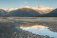 Reflections of Southern Alps in Cook River at sunset, Westland Tai Poutini National Park, West Coast, South Westland, UNESCO World Heritage Area, New Zealand